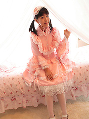 Adorable naked asian beauty in takes off her cute pink dress