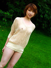 Cute asian babe shows off her naked plump tits under her sweater