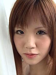 Slim redhead japanese teen girl posing