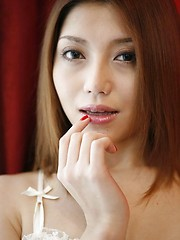 Sweet Japanese Aki Anzai in fishnet lingerie