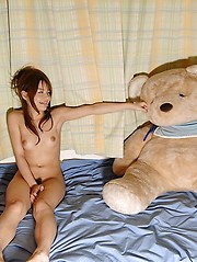 Tina Yuzuki sexy Asian model shows off her fine ass