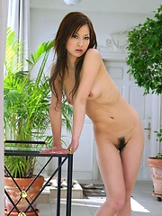 Ryo Uehara shows her hot hairy pussy and tits for a photo