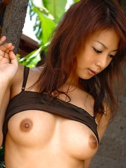 Lovely Asian model shows off her nice firm tits