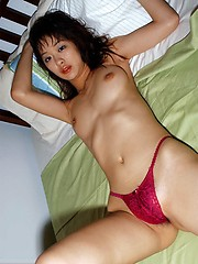 Lovely Asian model shows off her pert tits with her top off