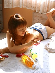 Pretty Asian teen is taking off the rest of her clothes