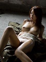 Hot Asian babe takes off her top and shows nice tits