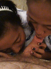 A pair of Filipina schoolgirls in hot threesome with tourist
