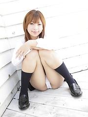Shy japanese girl  Yu Mizuki posing in school uniform