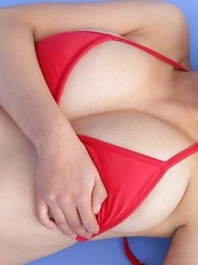 Hitomi Kitamura posing in red bikini her natural breasts.