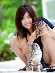 Large breasted Maki Kokoro posing outside