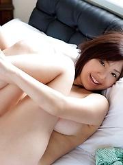 Busty asian Maki Kokoro posing