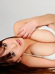 Gorgeous japanese big tits model Hitomi Tanaka posing in white bikini