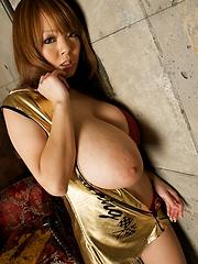 Picture set with Hitomi Tanaka posing in red bikini