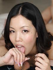 Japanese brunette Satomi Mana doing handjob