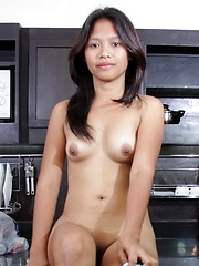 Naughty Hazel spreads her pussy lips in her kitchen