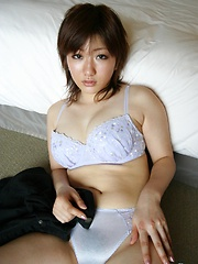 Miki Arakawa playing with her hairy pussy
