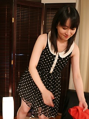 Japanese MILF takes off her clothes