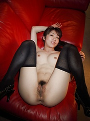 Jun in black stockings shows her booty