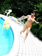 Ayami Sakurai posing in bikinis her big breasts