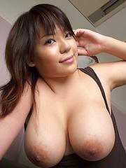 Busty asian Mitsuki An posing her natural big boobs