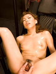 Japanese girl Kaoru Hayami plays with her hairy pussy