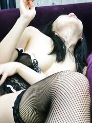 Nozomi Hazuki Asian in black lingerie sucks boner and eats cum