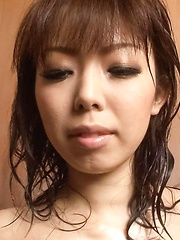 Yuki Asami Asian caresses her hot behind and vagina at shower