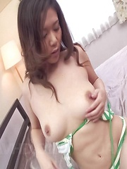 Minako Uchida Asian puts vibrator on clit and fingers her peach