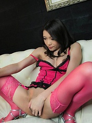 Ibuki Asian in pink lingerie teases slit with pink mini vibrator