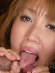 Yuki Mizuho Asian licks two dongs and sucks them with passion