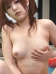Miku Airi Asian uses vibrators and caresses her boobies at pool