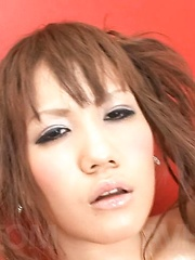 Mirai Asian with juicy titties arouses lower lips with vibrator