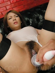 Rei Asian gets cum on face after is fucked with dildos in asshole