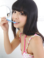 Sakura Sato Asian is sexy even when brushing her hair and teeth