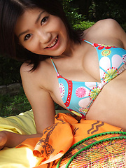 Noriko Kijima Asian with big tits in bath suit plays outdoor
