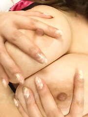 Yume Sazanami Asian with huge tits puts nipples between scissors