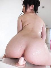Arisa Nakano Asian with hot behind rides fake cock till squirts