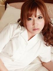 Sexy Kurumi Kisaragi poses on the camera in beautiful clothes