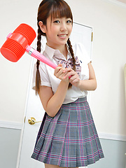 Mizuho Shiraishi Asian with uniform and pigtails plays like child