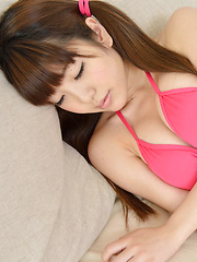 Mizuho Shiraishi Asian with pink bath suit and lon hair jumps