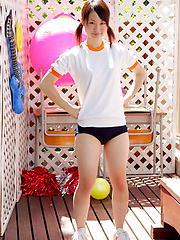 Naoko Sawano Asian in sports outfit plays with balls in garden