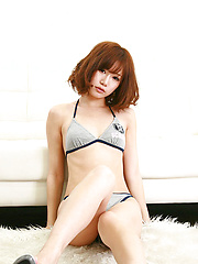 Ai Kumano Asian in bath suit moves with hot gestures on floor