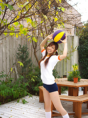 Cocoro Amachi Asianin shorts plays with ball and bike in garden