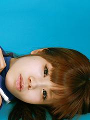 Asuka Nakano Asian with nasty smile poses in very short skirt