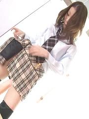 Nao Kojima Asian takes uniform off and fucks herself with dildo