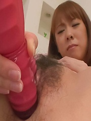 Asuka Asian doll sucks vibrator before sticking it in her peach