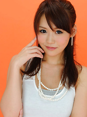 Yumi Asian is such cute and playful honey in white top and skirt