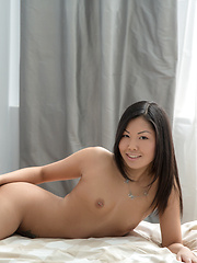 Horny Asian first timer strips off her panties to show her shaved pussy