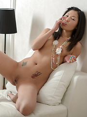 Stunning Asian beauty sucks the sweet cum from her fingers