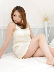 Rina Itoh Asian honey plays with her sexy lingerie and your minds